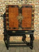 Waring & Gillow early 20th century cabinet on ebonised stand with coromandel & burr walnut veneer