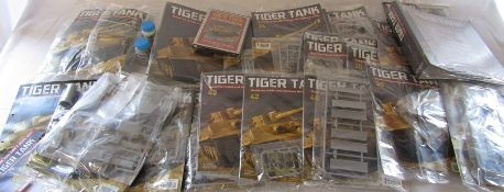 Approximately 22 build your own Tiger Tank magazines and parts by Hachette together with two folders