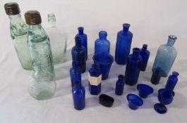 Various glass bottles inc blue poison and cod bottles, J Willatt & Co Nottingham, E Batty