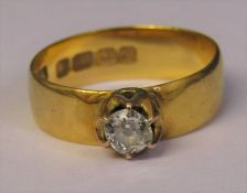 22ct gold band ring with central solitaire diamond 0.20 ct total weight 3.6 g size M