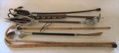 Selection of shooting sticks, walking canes etc