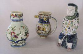 19th century Continental faience puzzle jug H 15 cm, Delft jug H 17 cm and a toby jug H 22 cm