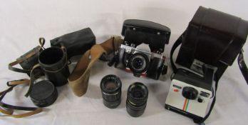 Praktica MTL 5B camera, Polaroid 1000 land camera and 2 lenses