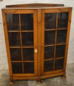 1930's oak display cabinet on bun feet Ht 123cm W 94cm