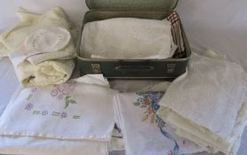 Small suitcase containing assorted linen