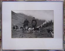 Framed black and white photograph by Lee Miller (20th cent.) entitled 'Rounding Up', reverse bears