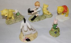 5 Royal Doulton Winnie the Pooh figurines:- Christopher Robin & Pooh WP10, Piglet Picking the