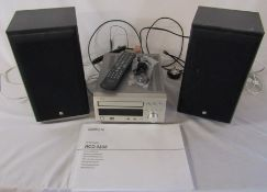 Denon RCD-M38 CD player with speakers and remote control