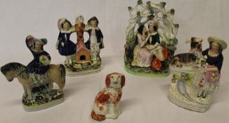 4 nineteenth century Staffordshire figures including lovers in bower, figure group with dog and