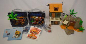 Playmobil pirate set in a case, a hut & a cave