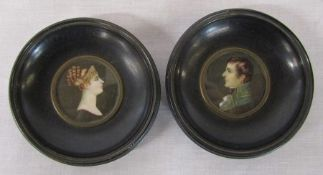 Reproduction portrait miniatures of a young man and woman in a black lacquered circular frames, both