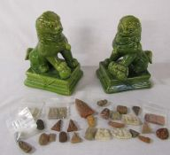 Pair of ceramic Foo dogs and assorted Buddha stones etc