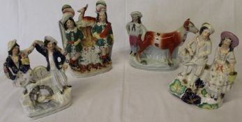 4 nineteenth century Staffordshire figure groups, 2 with clock face detail, man and cow (damage to