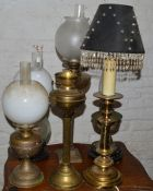 5 paraffin lamps & a table lamp
