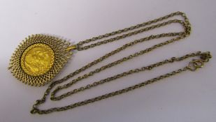 9ct gold chain with George V half sovereign dated 1903 in 9ct gold mount total weight 15.4 g