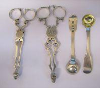 2 Georgian silver sugar nips weight 2.16 ozt & 2 Georgian silver salt spoons London 1820 weight 0.69