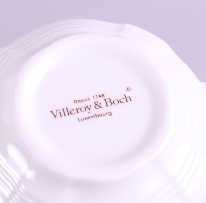 """Lot 27 - A collection of Villeroy & Boch """"Petite Fleur"""" pattern side plates, saucers and teacups with"""