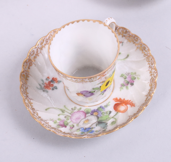 Lot 49 - Three 20th century Dresden cabinet cups and saucers, a larger similar cup and saucer, a Dresden
