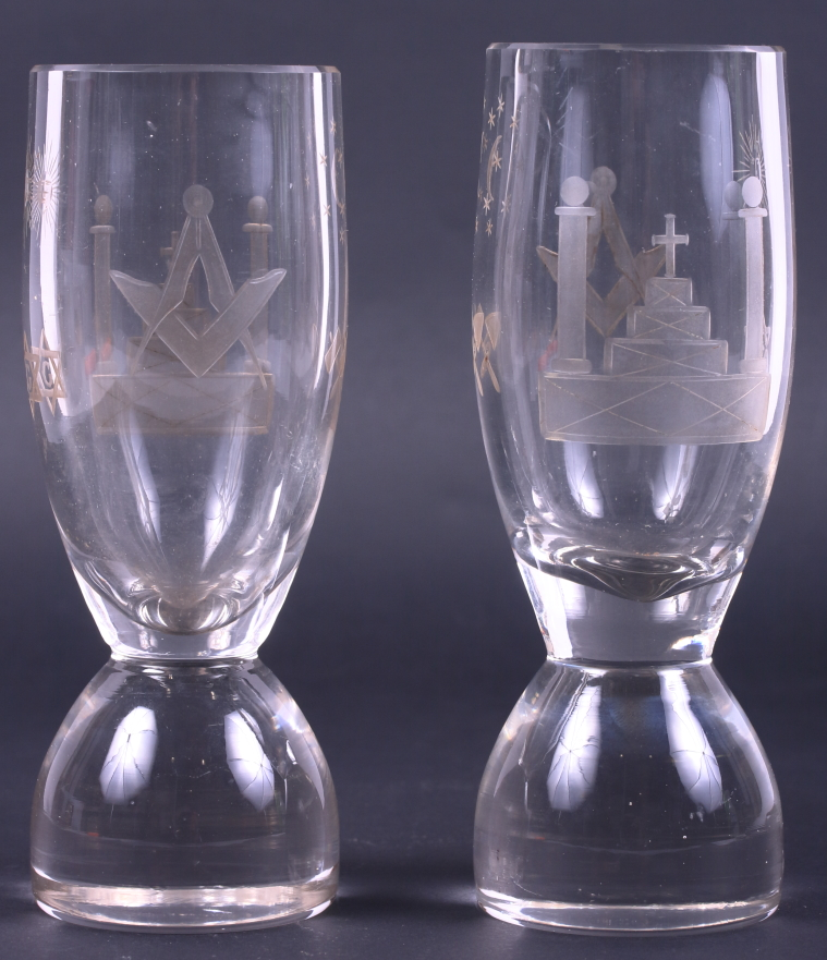 """Lot 16 - A pair of early 19th century Masonic firing glasses, on circular bases, 5 3/4"""" high"""