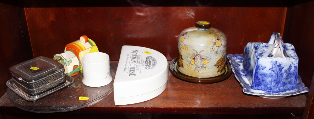 Lot 48 - A Chelsea Pottery cheese dish, a stilton dish, a Clarice Cliff style jam pot and sugar bowl, a