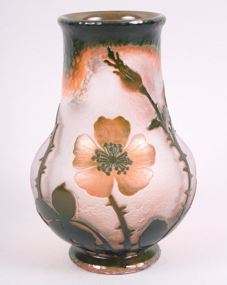 Lot 24 - A French overlaid and acid etched glass vase, decorated flowers, signed Daum Nancy to base, 6 3/4""