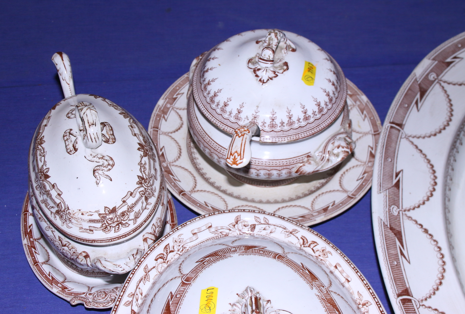 Lot 40 - A quantity of early 20th century china, including a turkey platter, tureens, ladles and under trays