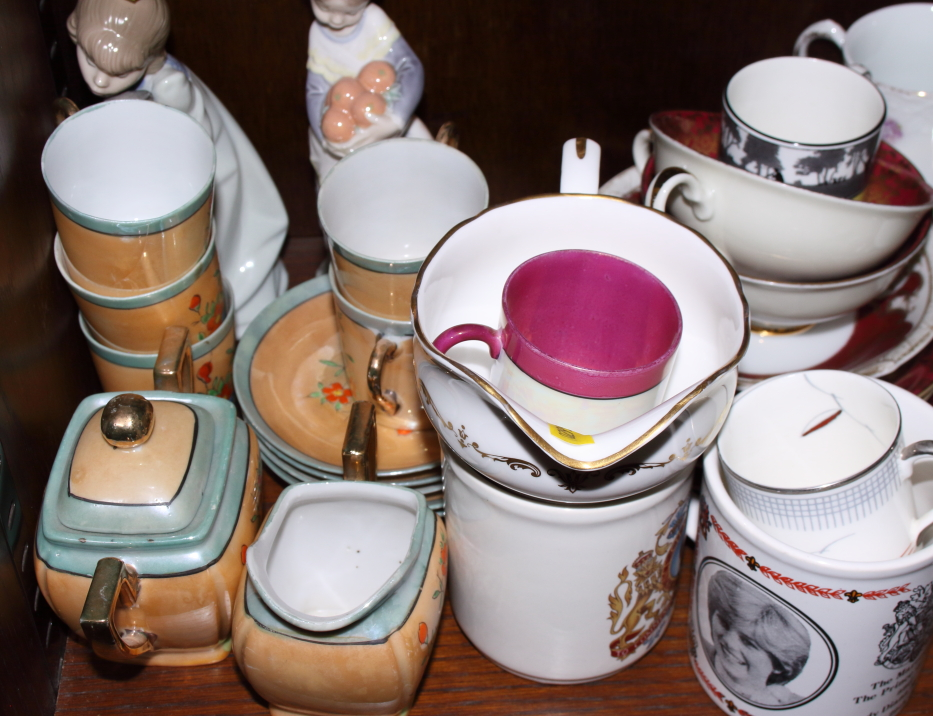 """Lot 51 - Two Lladro figures, 6 1/2"""" high, and a quantity of commemorative mugs, mixed cups and saucers"""