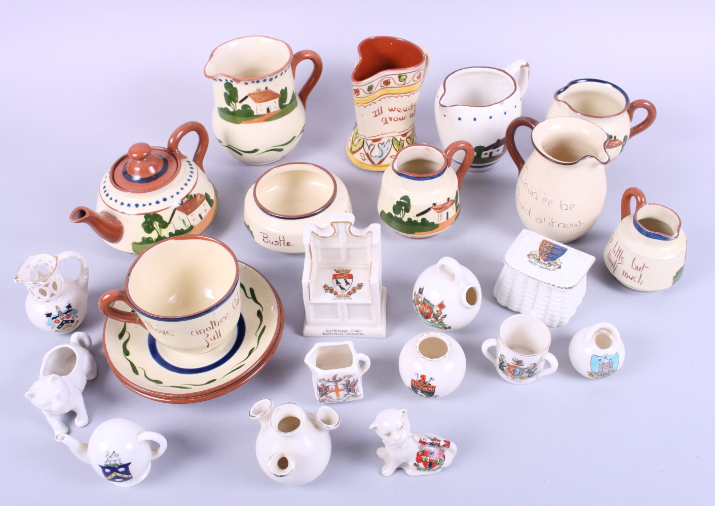 Lot 54 - A collection of Torquay/Mottoware pottery and a selection of crested china, various