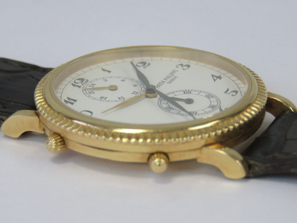 Lot 357 - An 18ct gold Patek Philippe Travel Time wrist watch complete with box and paperwork,