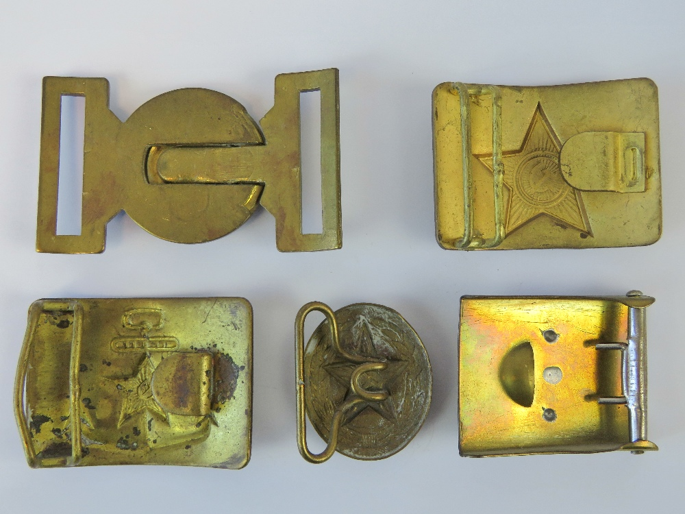 Lot 17 - Five brass military buckles; three Russian, one German and one British.