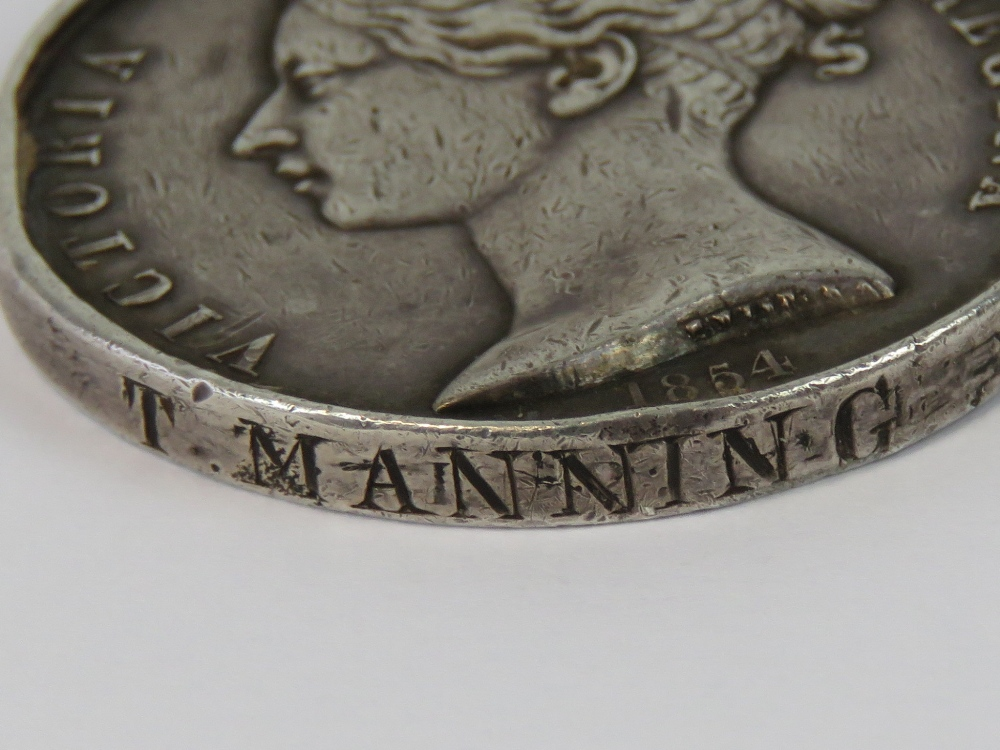 Lot 3 - A Crimea medal with bars for Balaklava and Alma and original ribbon, marked for T. Manning 13th LD.