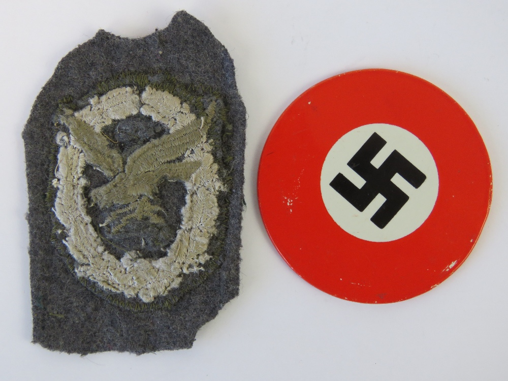 Lot 24 - A WWII Luftwaffe Air Gunners cloth badge, together with a mirror having swastika design to back.