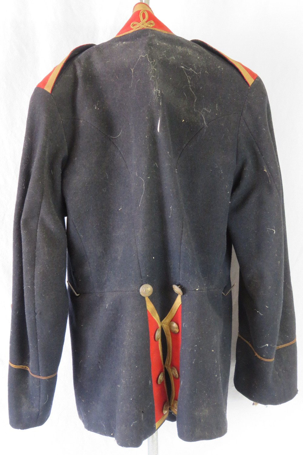 Lot 56 - A WWII US Military Band Corps parade tunic, in black with red details and original buttons.