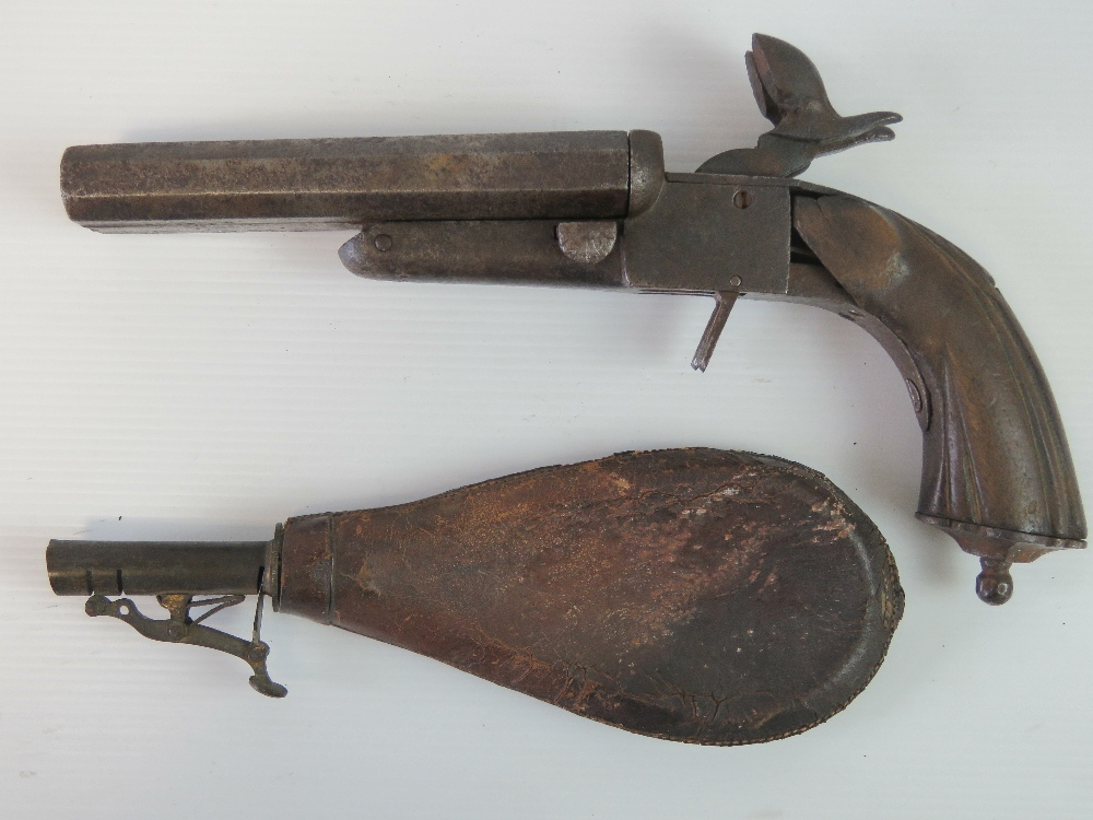 Lot 7 - A late 19th century twin barrel percussion pistol, with leather shot pouch.