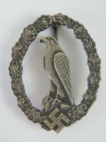 Lot 59 - A rare WWII German Luftwaffe Retired Pilot badge.