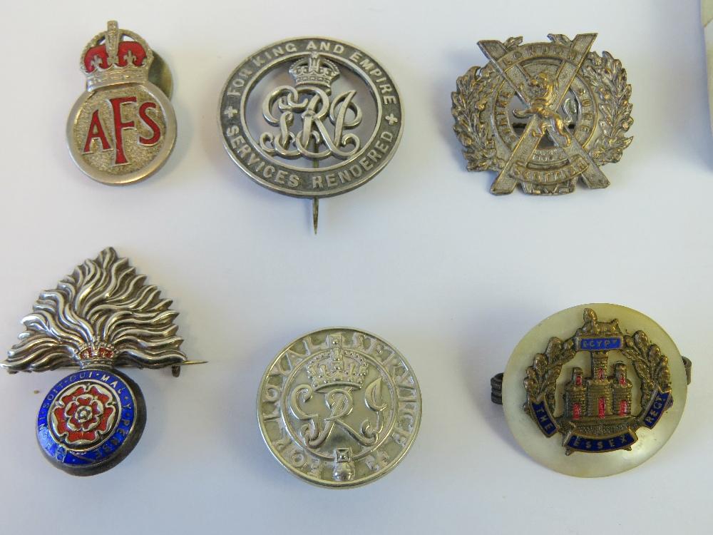 Lot 32 - A Sterling silver enamelled cap badge, together with a Sterling silver Regimental HAC crest,
