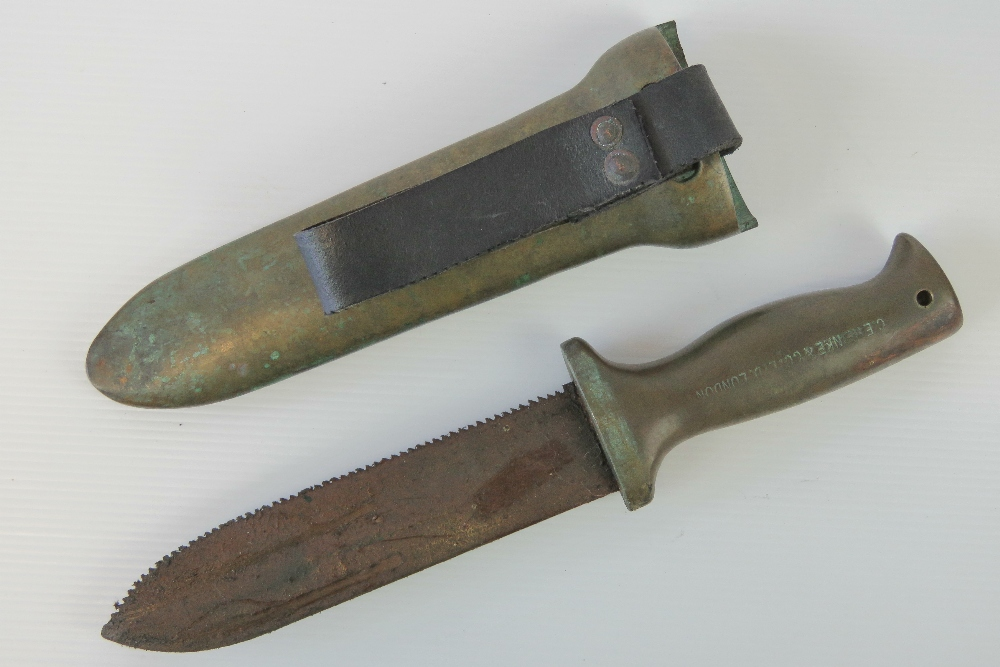 Lot 1 - A WWII Royal Navy Deep Sea Divers knife with serrated blade, in weighted brass scabbard,