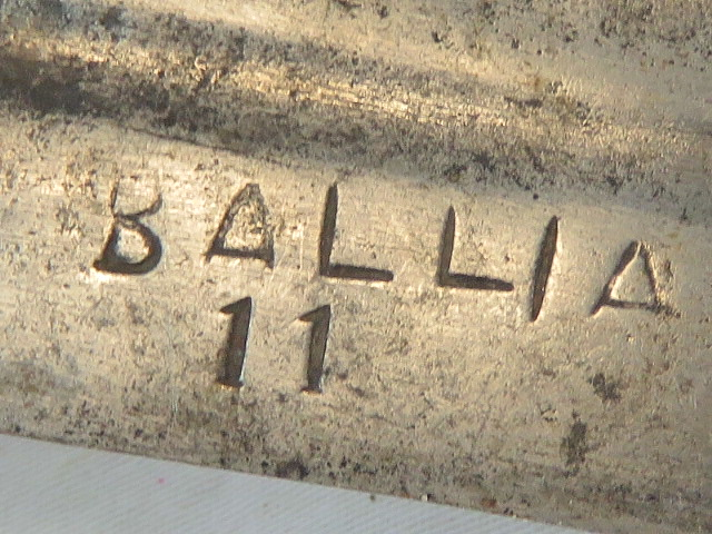 Lot 36 - An Indian Talwar sword having 75cm curved blade marked Ballia 11.