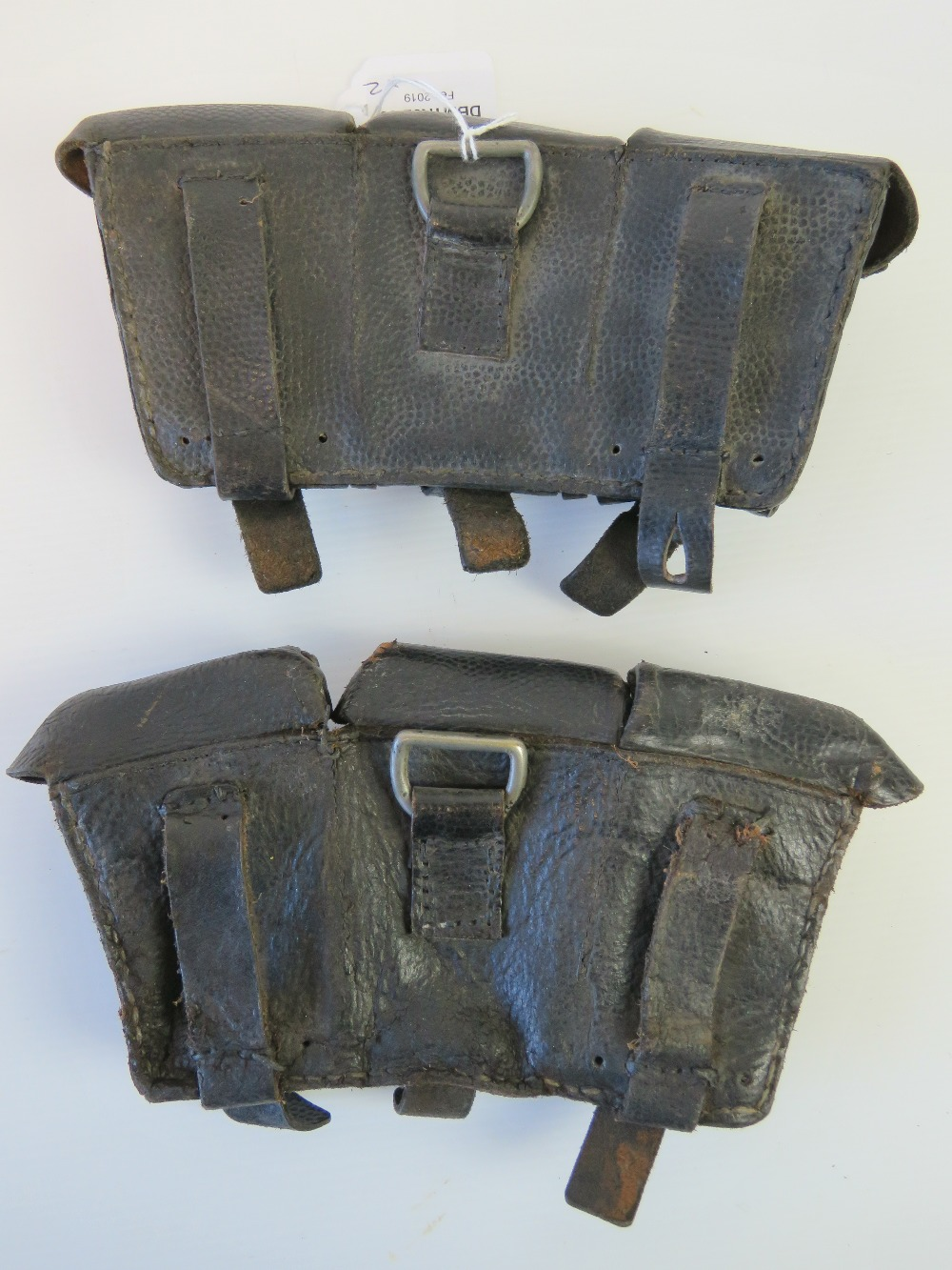 Lot 48 - A pair of WWII German Mauser K98 rifle black leather ammunition pouches.