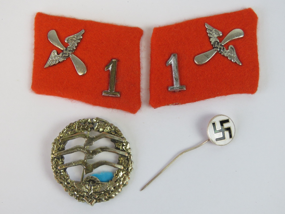 Lot 52 - A reproduction German NSFK badge, a pair of reproduction officers collar boards,