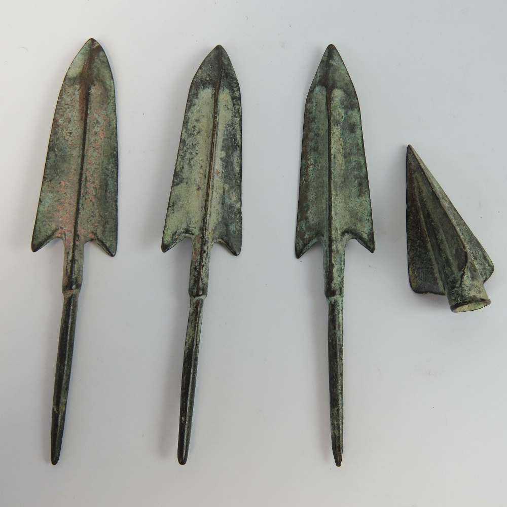 Lot 57 - Four bronze arrow heads.