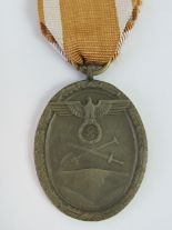 Lot 14 - A WWII German West Wall medal with ribbon.