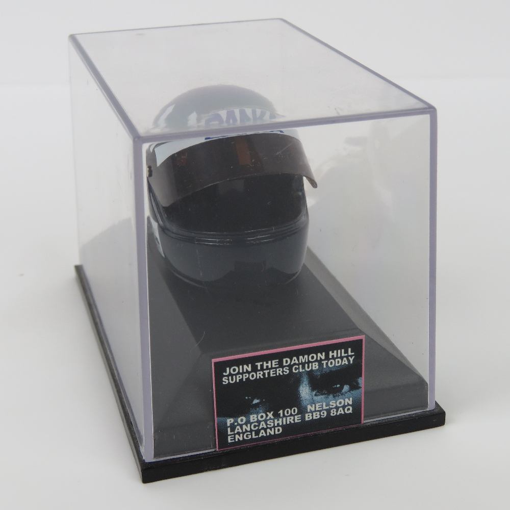 Lot 9 - A Damon Hill mini helmet dated 1997, tog