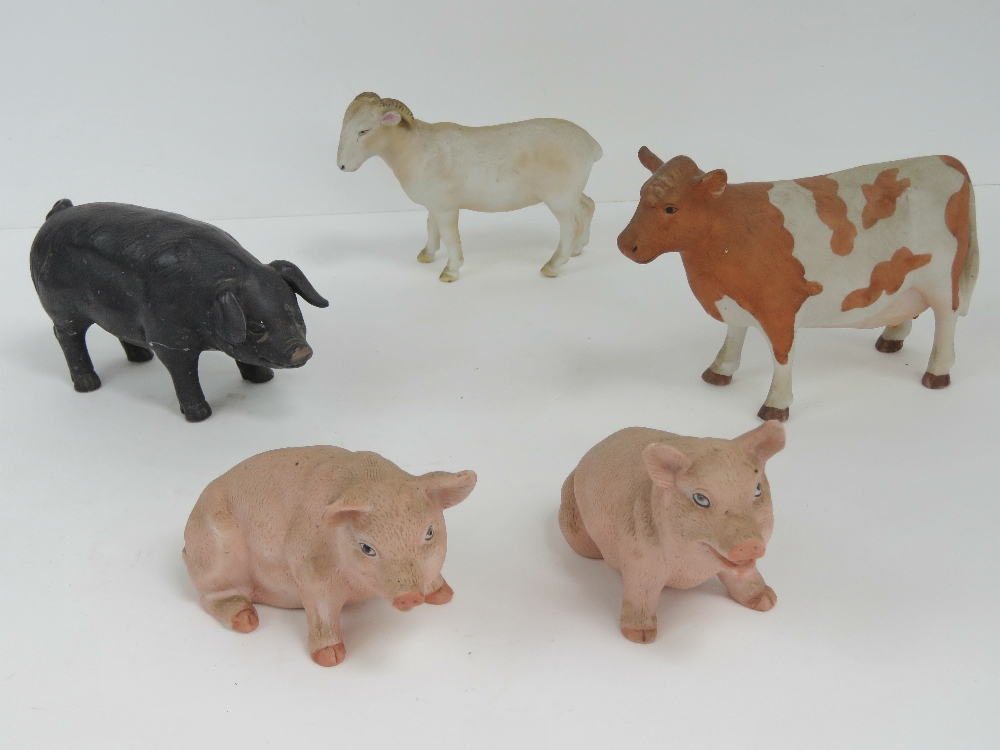 Lot 24 - Five ceramic animals including cow, goat and three pigs.