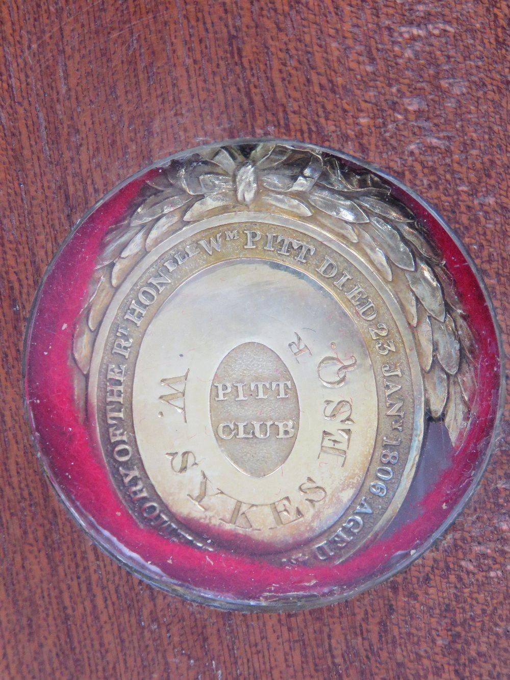 Lot 431 - A silver gilt oval Pitt Club badge,