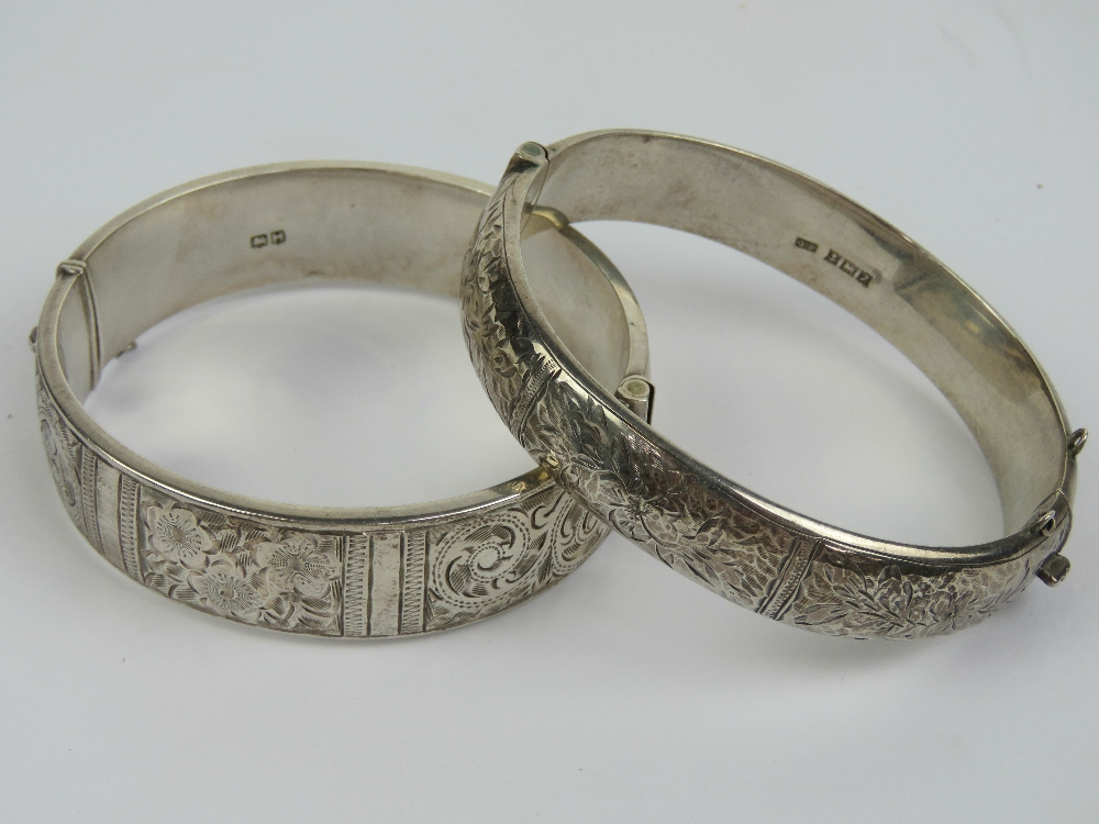 Lot 117 - Two HM silver hinged bangles each having