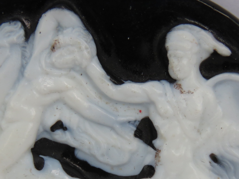 Lot 179 - A cameo panel in black and white having