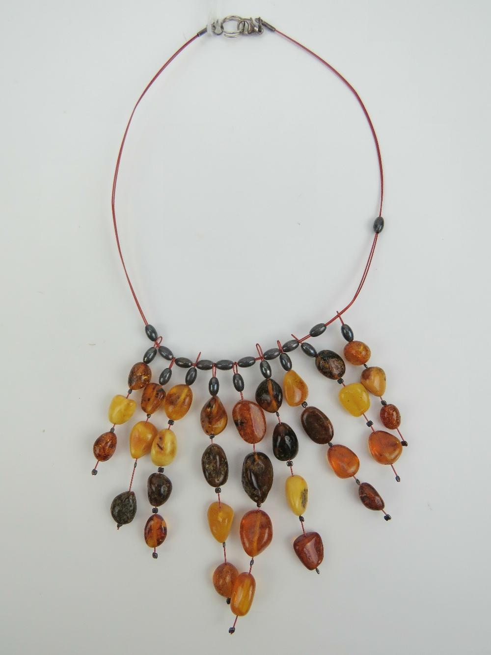 Lot 198 - A Baltic and 'Egg Yolk' amber bead neckl