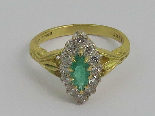 Lot 180 - A heavy 18ct emerald and diamond cluster