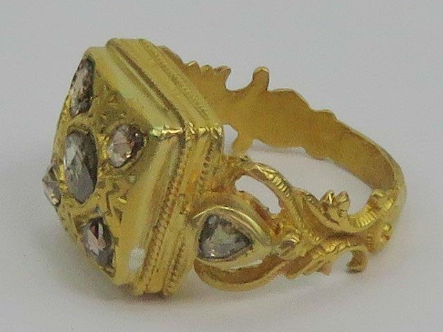 Lot 104 - A heavy Etruscan Revival yellow metal ri